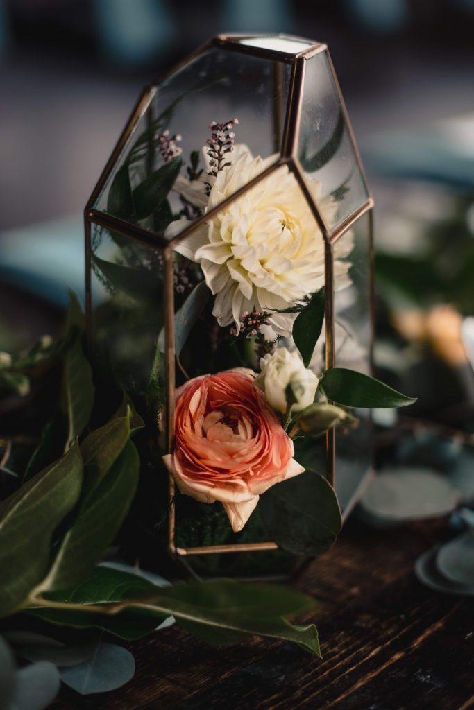 Terrarium geometric shapes and gold as wedding centerpieces in Colorado
