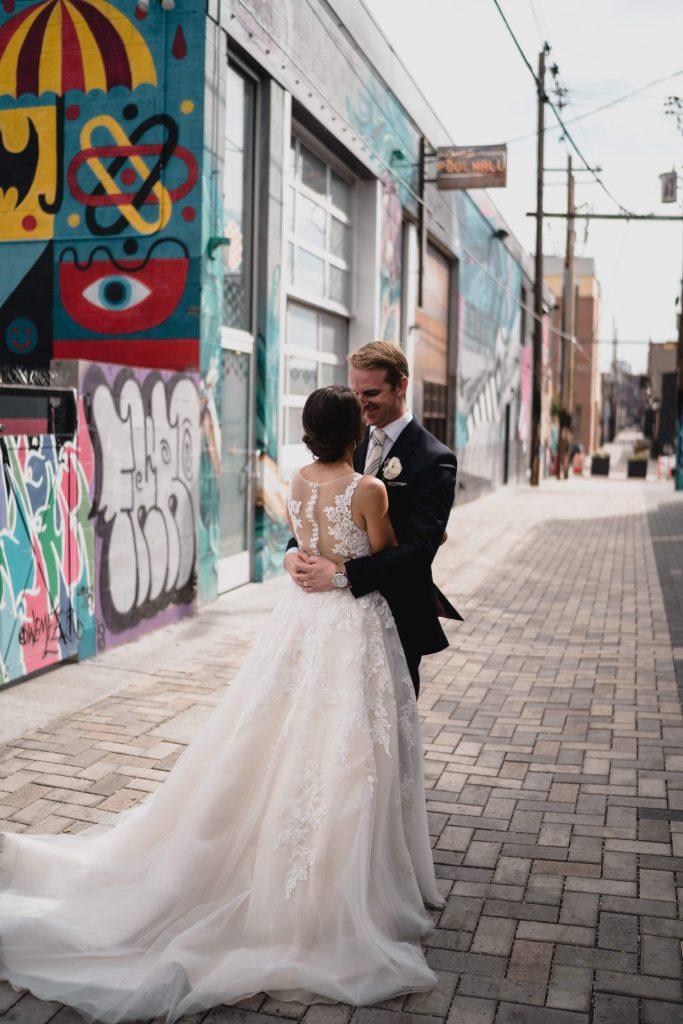 BrewHop Trolley provides transportation for wedding photography backdrops like this Denver Colorado alleyway
